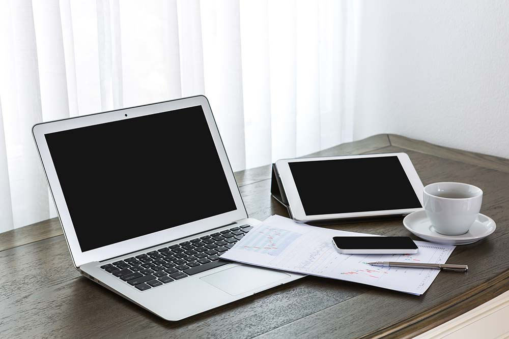 Laptop mobile and tablet at a designers workplace