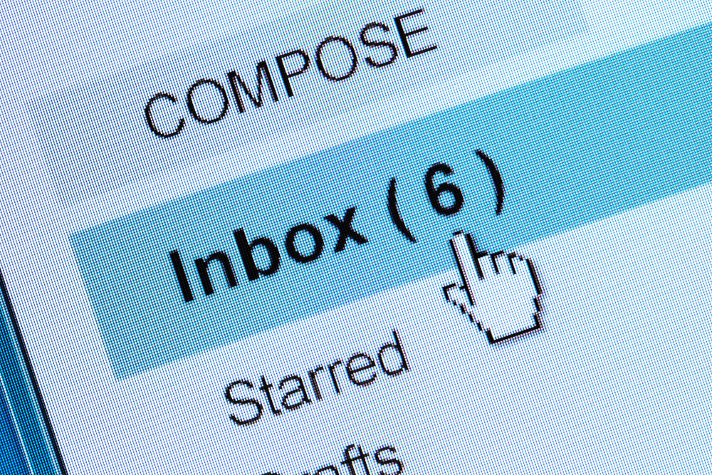 Email user clicking on their inbox to view email marketing campaigns